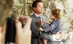 CUTE!  Exton Downey playing with his dad's tie during a photoshoot for the October 2014 issue of Vanity Fair.  #RDJ  #Robert Downey Jr.