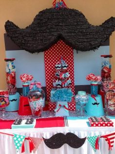 Mustache party - Candy Bar! I'm sure she'd love this! Where does one find a mustache pinata though?