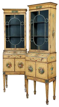 A pair of George III style cabinets made approx1900  Sold for $2,000  ( they need restoring ) at Doyle New York.