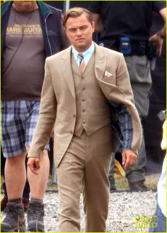 Leonardo DiCaprio filming the Great Gatsby! I love his suit! Maybe something like this with a white shirt and mint tie for the groom and only vests for the groomsman....