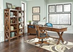 With the warm burnished brown finish flowing beautifully over the X design details along with the faux mortise-through accents and framed details the Burkesville Home Office Set from Signature Design by Ashley creates a warm inviting rustic atmosphere perfect for any home office