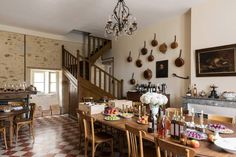 Table as counter space, free standing, Pans on wall, Restored 1880 French Kitchen French Country Kitchens, French Country Decorating, Country French, Mimi Thorisson, Huge Kitchen, Bistro Kitchen, Vintage Appliances, Upper Cabinets, Interior Styling
