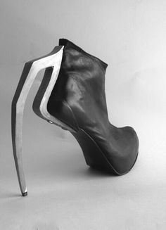 Extreme shoes - external steel heel - see more here http://www.indiatimes.com/lifestyle/style/will-you-ever-wear-these-cringeworthy-heels-227992.html
