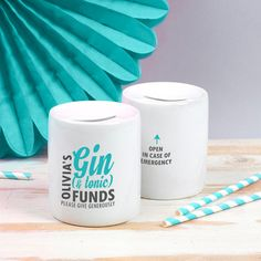 A gorgeous gin and tonic funds money box for every g&t loving lady!  This lovely money box is a fun and playful must-have for every g&t loving lady - and will certainly help with saving all her pennies for a rainy day... or a fabulous bottle of gin!  With its bold typographic print and bright colours, shell be proud to show it off anywhere in the house, with the gentle humourous reminder to Please Give Generously!  The reverse is emblazoned with the words Open In Case Of Emergency.  P...