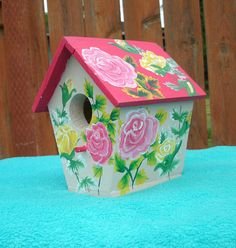 This is a handmade wood bird house that was painted with Acrylic paint. It measures 6.25 inches tall, 5.5 inches wide, and 5.5 inches deep. It is constructed of 1 inch pine board, wood glue, and brads. The roof and floor of the house have been milled down to 1/4 inch. The entrance hole measures 1 1/4 inches. I painted it with beautiful realistic looking Roses and leaves. The colors are cheerful, and bright, a colorful decoration for any garden or home.  If you would like to have a h...