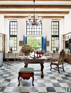 Black and white check floors in this foyer | archdigest.com
