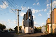 OOF! Architecture turned a rundown Victorian weatherboard cottage into a jaw-dropping compact home on a tiny triangular lot in Melbourne.