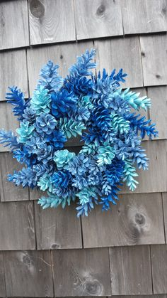 Small Little Beauty - Maine Pinecone Wreath in Blues Blue jay, sky blue, made in Maine, hand tied wreath, pine cones This sweet little wreath is 12 Pine Cone Art, Pine Cone Crafts, Pine Cones, Pine Cone Wreath, Christmas Fun, Christmas Wreaths, Christmas Decorations, Christmas Ornaments, Country Christmas