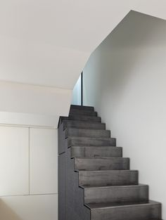 Law Street House by Muir Mendes - blackened steel staircase with storage space