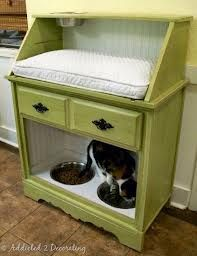 Three drawer from guest room...remove two bottom drawers, add single door, cut opening on one end = litter pan! Instead of bed on top, food/water bowls. Very top needs to be wider = kitty seat to look out the window.