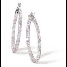 """NWOT In and Out CZ Sterling Hoop Earrings Sterling Silver and brilliant CZ Hoop Earrings with Click Closure. CZs set on the visible inside and outside halves of the hoops. Approximately 1 3/16"""" in diameter. Jewelry Earrings"""