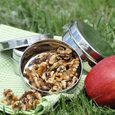 This compact snack pack is perfect for all your snacking needs from running errands to an afternoon on the playground. The small round container, can old up to 1/2 cup of wet foods, is good for applesauce, cut fruit, nuts & berries (note, since no plastic is used the container may leak a bit).