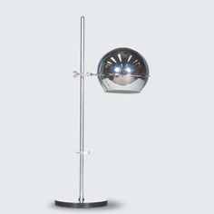 RAAK CHROME ORB TABLE LAMP line Stunning chrome table lamp with a black metal base, perspex adjustable fittings and ball stand which allows the lamp to lean and distribute light from different angles. Mid Century Lighting, Modern Times, Black Metal, Angles, Floor Lamp, Restoration, Chrome, Table Lamp, Base