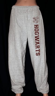 Harry Potter Hogwarts Sweatpants by AlpineStoneApparel on Etsy.  I have these, and they are super cute but I think they were made for Hagrid. They are freaking HUGE and even a size smaller than I normally wear.