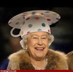 Queen Elizabeth wearing a teacup hat