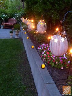 Designer Melissa Valeriote created a lovely, luminous Halloween display for her backyard using faux pumpkins, string lights and candles. Click through to see more of her Halloween decorating ideas. Halloween Displays, Holidays Halloween, Halloween Party, Halloween Decorations, Halloween Ideas, Halloween Stuff, Autumn Decorations, Halloween Projects, Halloween Costumes