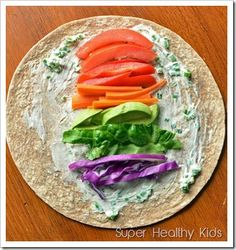 rainbow wrap: tortilla, chives/cheese spread, red peppers, carrots, avocado, lettuce, purple cabbage