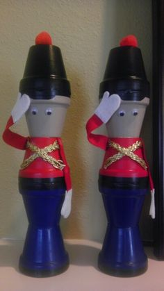 DIY holiday craft! I spray painted some pots, glued them together, added ribbon detail for the shirt and cut out the arms and hands from felt. I also used electrical tape for shoes, a belt, and the hat brim. Glued on some eyes and a red poof and voila!  Soldiers to display on my mantle at Christmas.