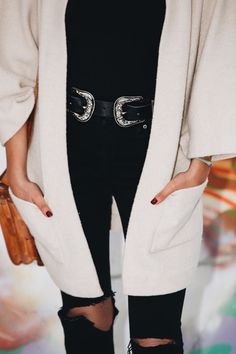 I love the neutral colors and ripped knee jeans! Perfect fall outfit idea.