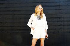 club monaco white kendra romper, white longline vest, black peep toe ankle booties, ysl cassandre crossbody, layered silver necklaces #fashionjackson