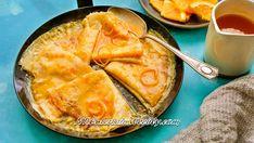 Get Crepes Suzette Recipe from Food Network Grand Marnier, Crepe Suzette Recipe, Orange Syrup, Crepe Pan, Cream Liqueur, Baking Parchment, Clarified Butter, Blood Orange, Serving Plates