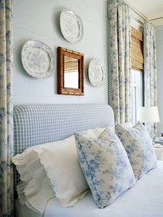 cottage bedroom- Love the mix of the checked headboard and floral drapes. Pretty blues!