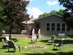 Lake Camelot Water Front Home  3 Bedroom 2 Bath with everything on main floor.  Master Bedroom has a Gas Log Fireplace Walk in Closet Full Bath and laminate flooring.  Jetted tub in Master Bath.  24 x 14 Three Season Porch is Insulated and has Thermopane Windows.  Deck has Retractable Awning.  Back Yard complete with Fire pit Sandy Beach and Pier. Basement is unfinished but plenty of room to do what you want with it.  This one wont lase long  Not real busy boat activity as property is…