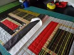 Joining quilt as you go blocks.