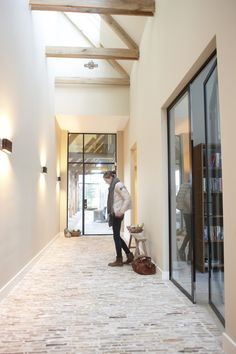 hallway with brick floor