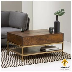 This antique looking wooden coffee table teamed with a contrasting brass frame with functional storage is for something a little different in the living room. Visit giovanniboutique.com and get custom crafted furniture at your doorstep. #BoutiqueFurniture #CustomCrafted #HomeDecor #Furniture #ModernHome #LuxuryFurniture #CoffeeTable #Table #BrassFinish #LivingRoom