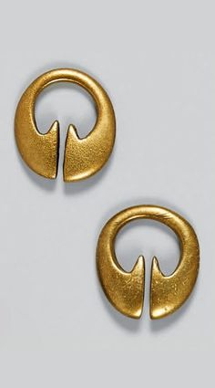 Indonesia - Bontoc | Pair of small 'dinomog' earrings from the Ifugao people.  Brass.  H: 2 cm