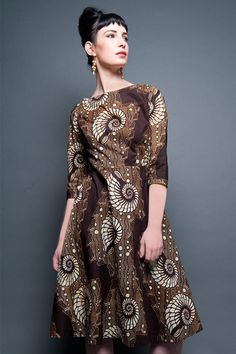 Gorgeous and elegant African print dress with 33/4 sleeves and flared skirt. Available from http://sapelle.com