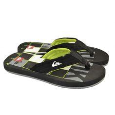 Flip flops de entrededo fabricadas con materiales de goma y corte de tejido, con detalles en la plantilla de la marca QUIKSILVER.
