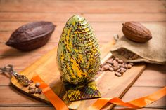 An impressive and unique take on the classic Easter egg. These Easter eggs are 200 mm tall, and can take 18 of our chocolates. They are made of high quality 75% single origin Tanzanian dark chocolate.Decorative and delicious gift on its own, even more lovely when filled with chocolates.These chocolate Easter eggs are individually hand-decorated, no two are identical. The decoration we use is cocoa butter based edible food paint. Cocoa butter is a native ingredient of chocolate, and…