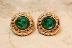 Christian Dior Poured Gripoix Glass Emerald Green Gold Plated Earrings are set with a gorgeous emerald green marbled gripoix glass cabochon in a domed setting surrounded by an egyptian revival or azte