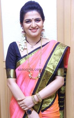 "Tamil TV anchor Divyadarshini in silk saree at ""Motta SIva Ketta SIva"" movie launch. She wore pink silk saree with black blouse. Jewellery and flowers adde"