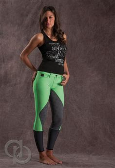 Nice Lime Green / charcoal grey Breeches, black tanktop with white chalky script, chestlength wavy dark hair