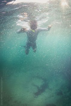 Snorkeler drowning in the sea by Jovana Milanko