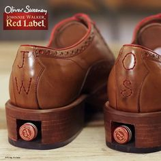 JOHNNIE WALKER Oliver Sweeney Brogue is a limited edition pair of handcrafted leather Oxfords that conceal a small bottle of Johnnie Walker Red in the sole.