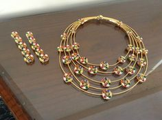 Contemporary twist to Indian Navratan jewellery. Necklace and earrings.