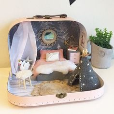 To those of you that voted, the pink was a close second in the revealThis little suitcase doll house is for a stylish 5 year old girl.lots of pinks and greys and even a cosy corner under a mini cano Modern Dollhouse, Diy Dollhouse, Dollhouse Miniatures, Miniature Rooms, Miniature Houses, Doll Furniture, Dollhouse Furniture, Kids Canopy, Mini Doll House
