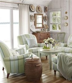 Love Sarah Richardson's cottage design - great idea to use 4 comfy chairs instead of a couch gathered around a nice coffee table.