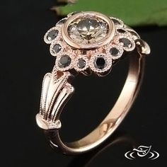 I don't like the colors, but the setting is cool. BEZEL STYLED FLORAL RING