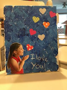 I LOVE YOU CANVAS   Supplies Needed: Canvas (we got ours at Michael's) Acrylic Paint Paint brush and/or sponges Scrapbook paper for hearts Scissors Glue Picture  White paint pen or paint and small brush Picture of child/children