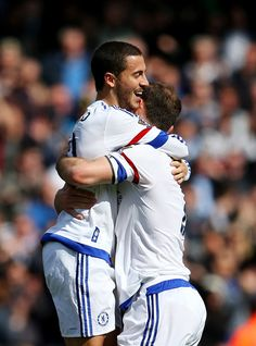 Eden Hazard Photos - Eden Hazard of Chelsea celebrates with Branislav Ivanovic of Chelsea after scoring his sides second goal during the Barclays Premier League match between A.F.C. Bournemouth and Chelsea at the Vitality Stadium on April 23, 2016 in Bournemouth, United Kingdom. - A.F.C. Bournemouth v Chelsea - Premier League