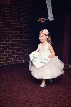 """This is happening, flower girl sign instead of petals.  That way if they get nervous or are super young they don't have to remember to """"do"""" anything just walk in and smile!"""