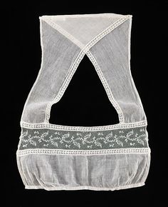 French cotton Tucker.  ca. 1820   Precursor of the modern brassiere, this tucker was worn as a modesty piece under the sheer cotton empire line dresses of the early 19th century.