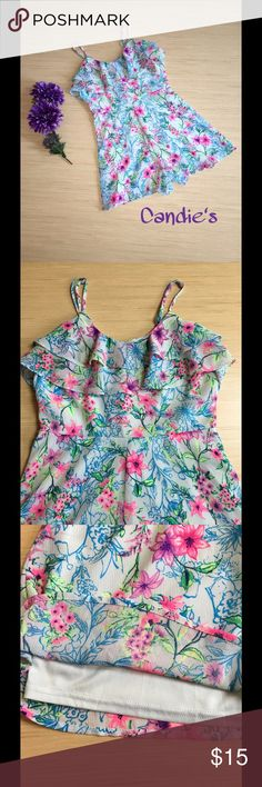 Candie's Floral Romper Size 3 (Junior's) Brighten up your day with this preloved Candie's floral romper! This romper is light blue with a very vibrant, fluorescent floral pattern. The fabric ruffles along the bustline and the shoulder straps are adjustable. It also zips in the back. The romper is fully lined. It also has small belt loops on each side so a belt could be added. The romper is 100% polyester. This is a Junior's size 3. Candie's Other