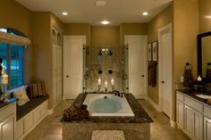 A window seat and Roman shade flank a richly-tiled tub and glistening glass shower. The Bellwynn model from Toll Brothers at Preserve at Flower Mound. Home Source New Home Source, Home Builders, Home, New Homes For Sale, Estate Homes, Amazing Bathrooms, New Homes, Beautiful Bathrooms, Luxury Homes