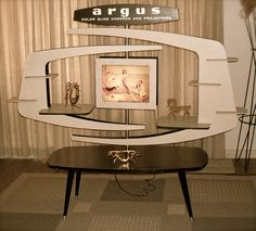 1950's Argus cameras factory in-store display, here shown in a private residence. In the day, each shelf would have an Argus product for a customer to discover.